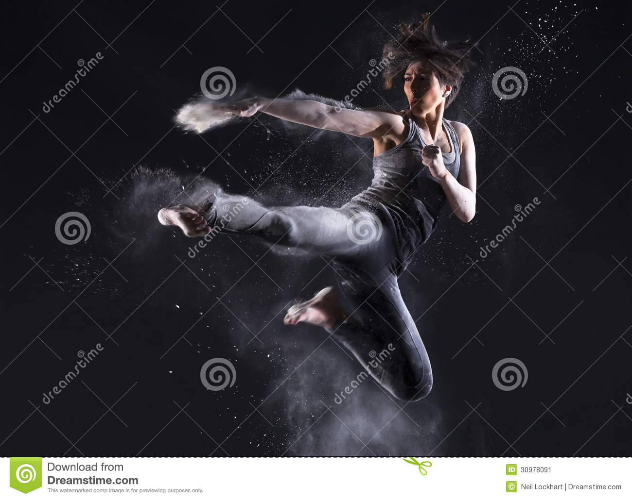 Female Martial Artist With Powder Jump Kick Stock Image ...