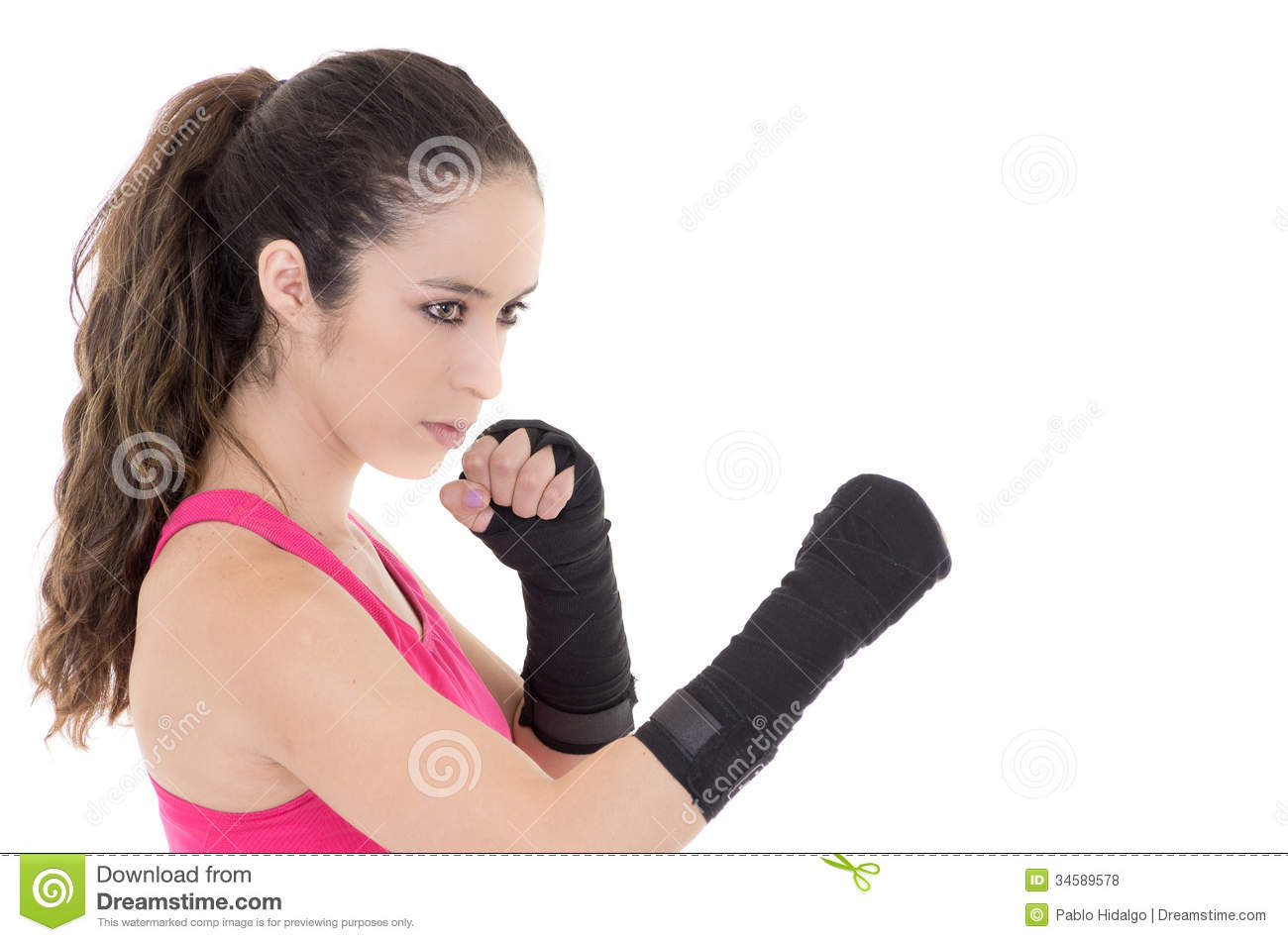 Female mixed martial arts fighter in MMA style gloves strikes a fight ...
