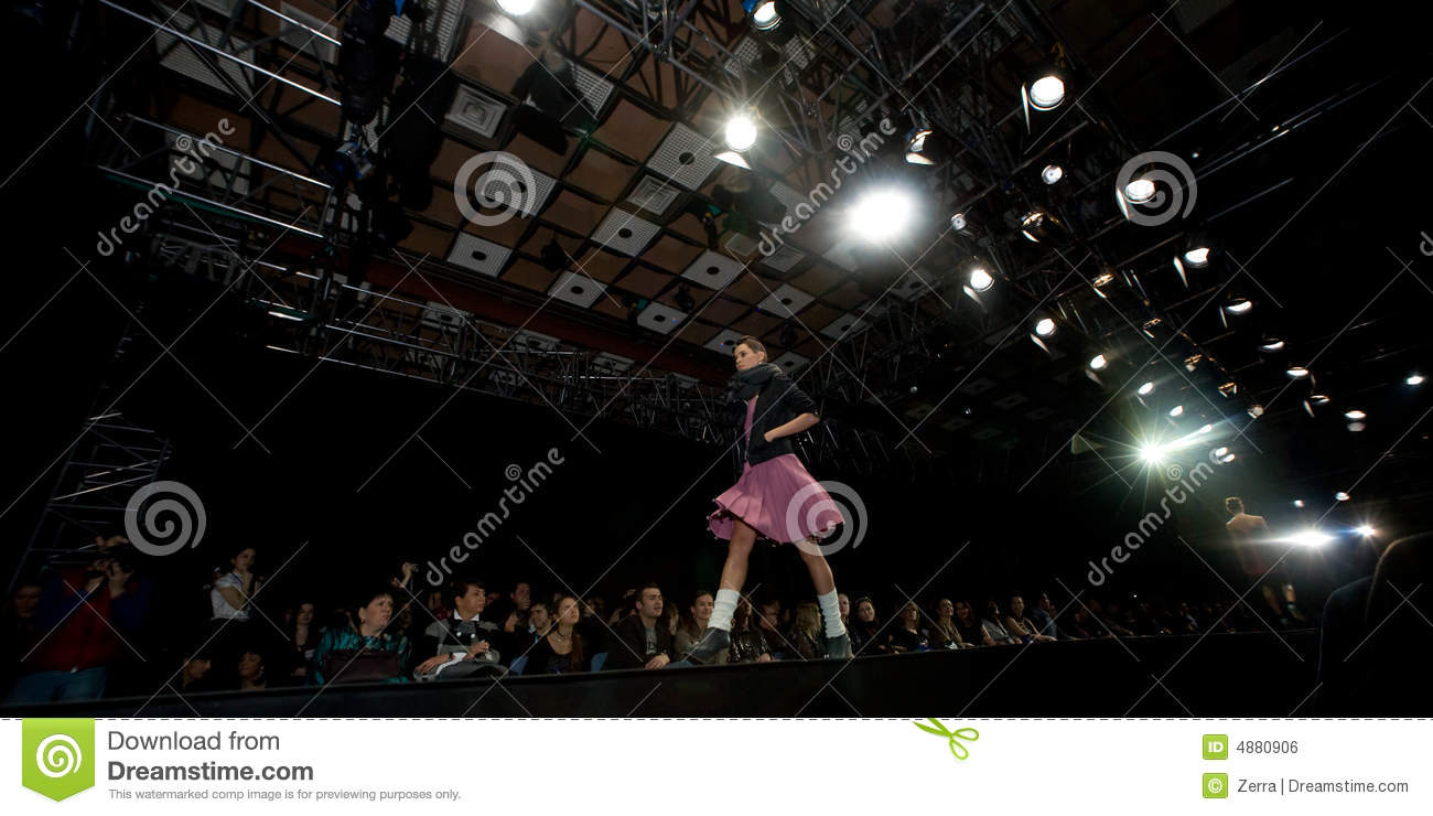Female model at a fashion show on the catwalk (Rus
