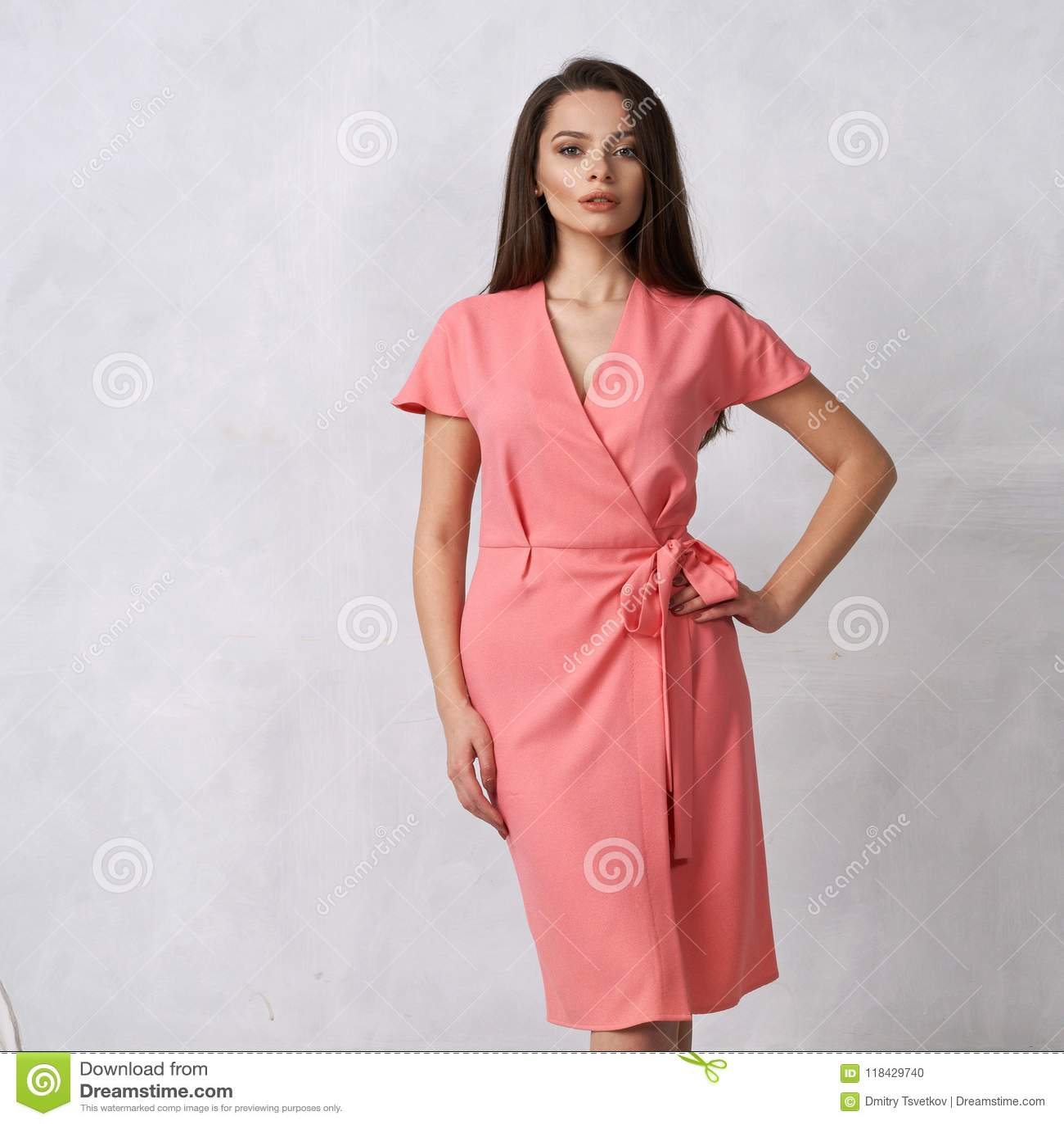 Female Model In Pink Wrap Around Midi Dress Stock Photo