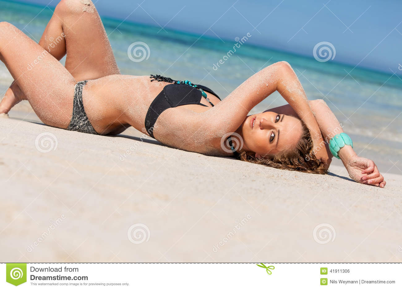 Female model wearing black bikini in the water