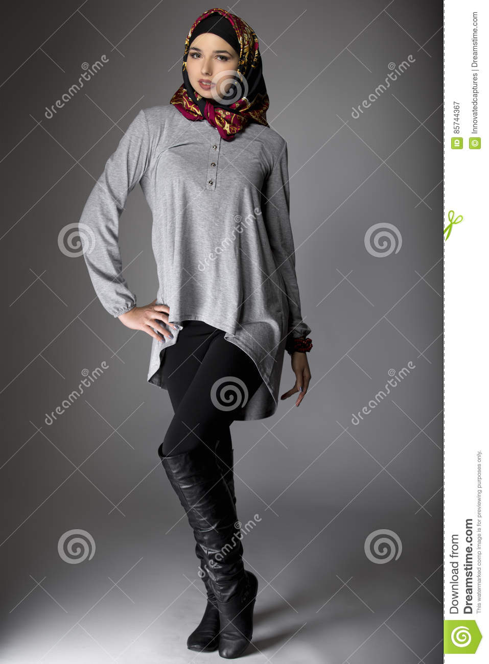386bad226ca Multiracial female wearing a stylish red hijab mostly associated with  middle east