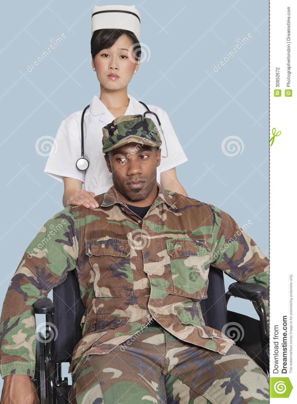 Female Nurse Comforting Disabled US Marine Corps Soldier In ...