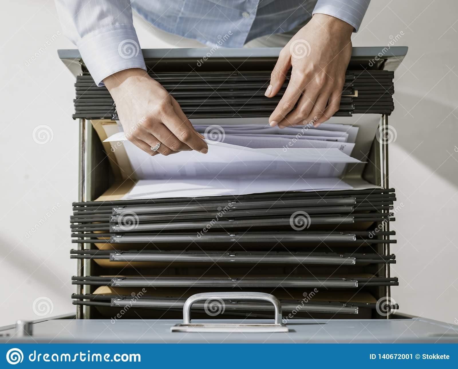Office worker searching files in the archive