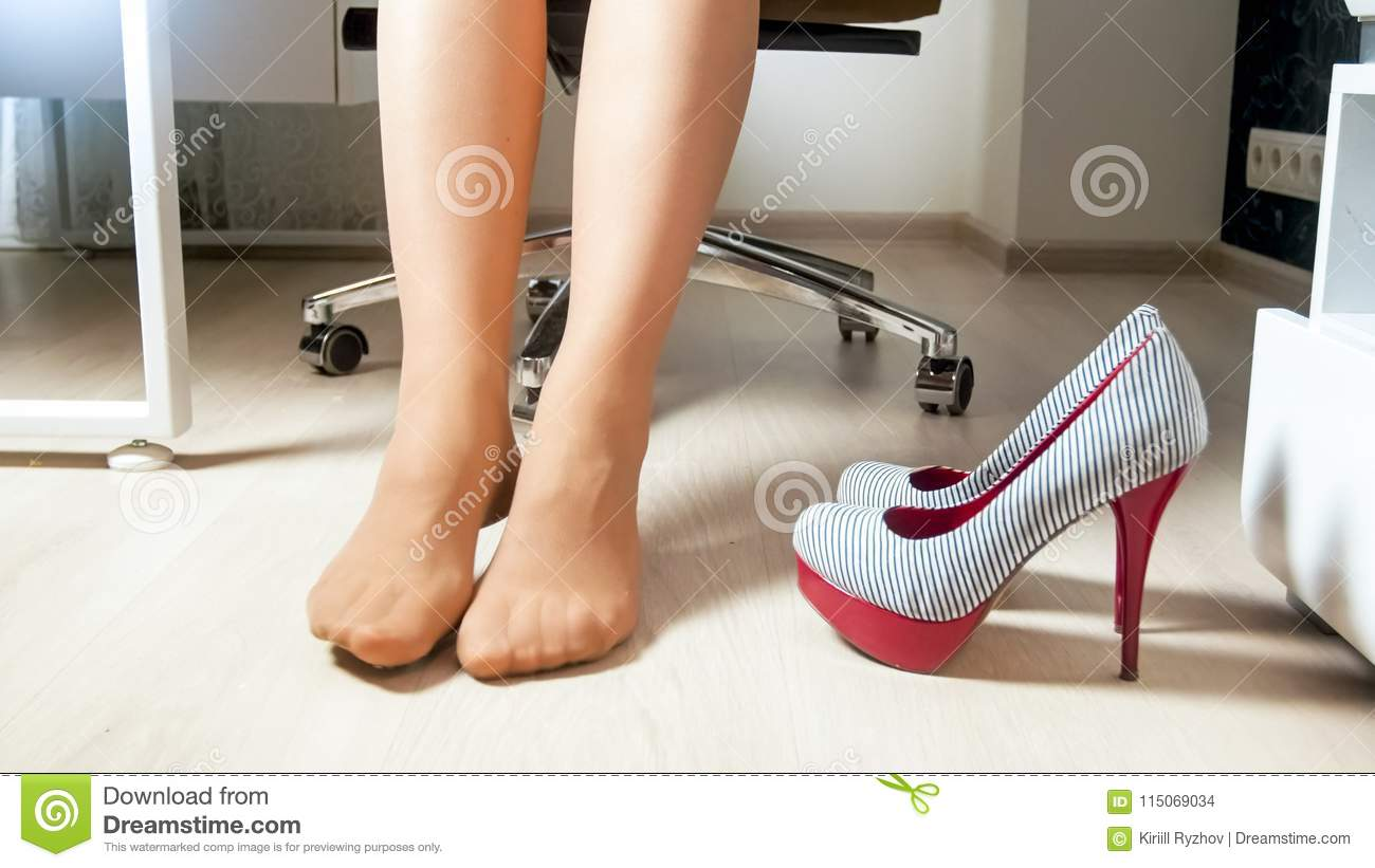 c3372107c30 Young Female Office Worker Took Off High Heels Shoes Under Table ...