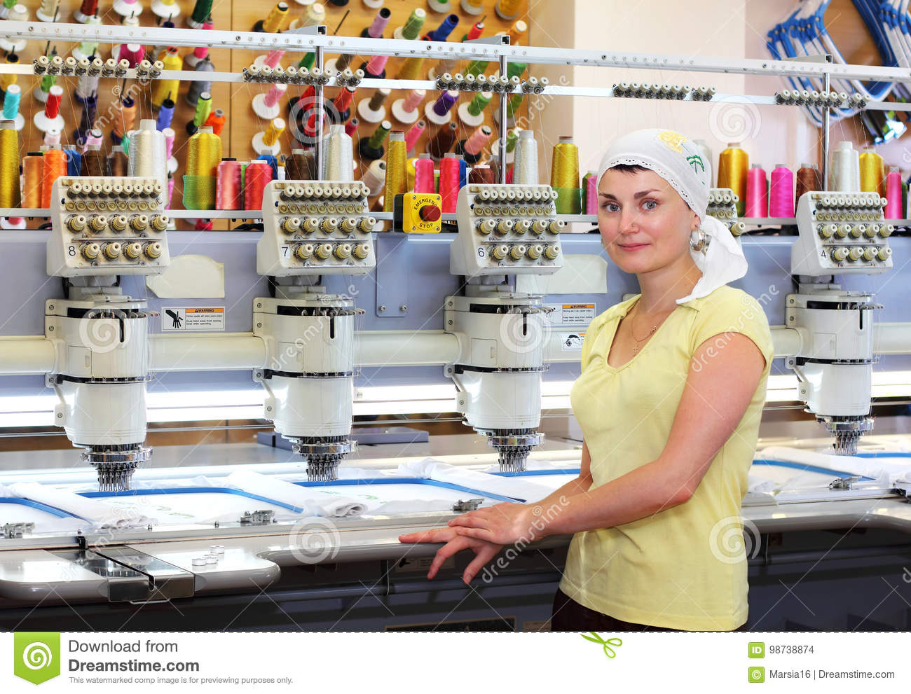 female operator of automatic embroidery machines stock