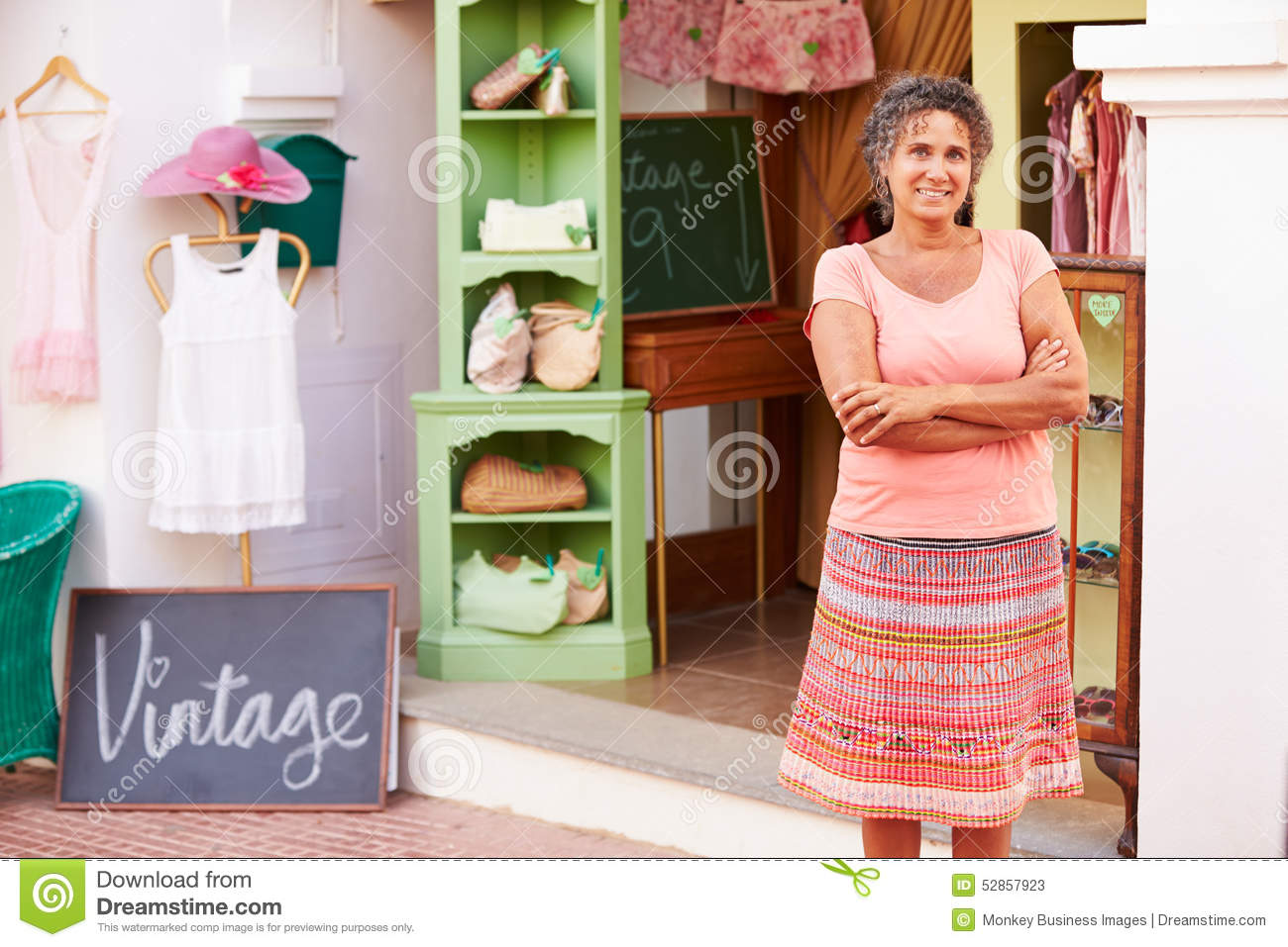 Female Owner Of Fashion Store Standing Outside Shop