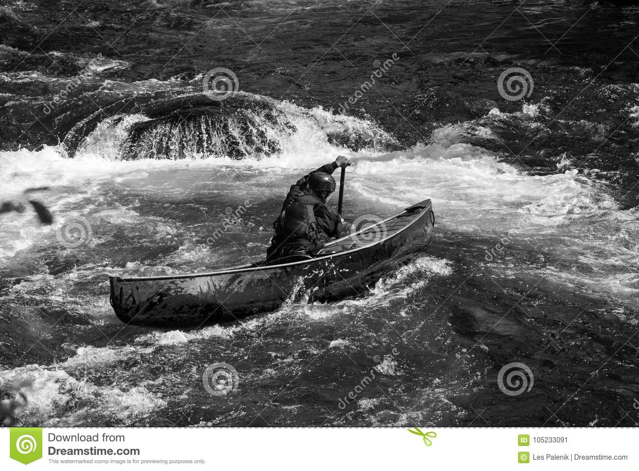 Female Paddler In A Whitewater Canoe Stock Image - Image of