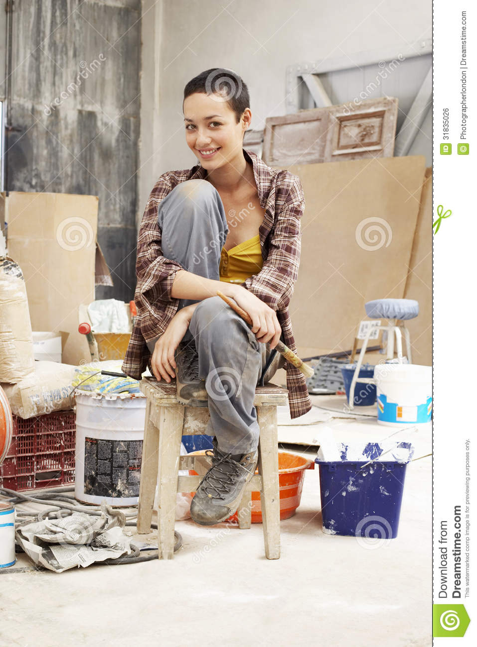 Female Painter Sitting On Stool In Work Site  sc 1 st  Dreamstime.com & Female Painter Sitting On Stool In Work Site Royalty Free Stock ... islam-shia.org