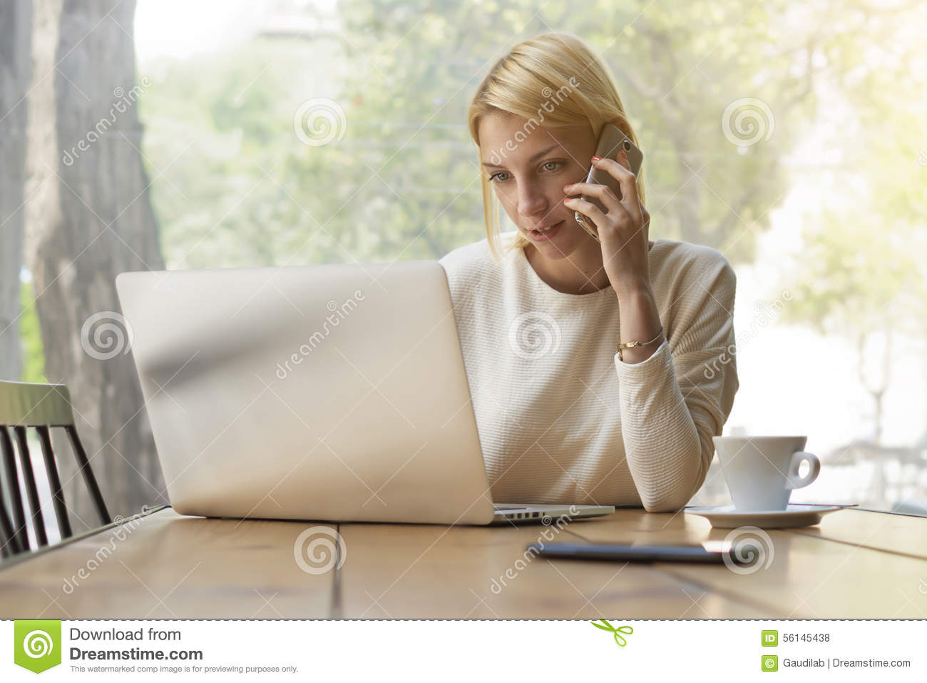 Female person busy working in modern office interior or coffee shop