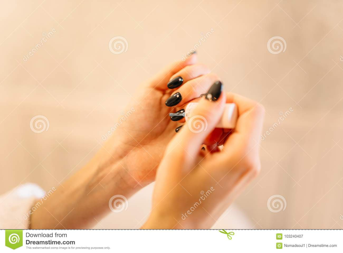 Female person hands with nail polish closeup