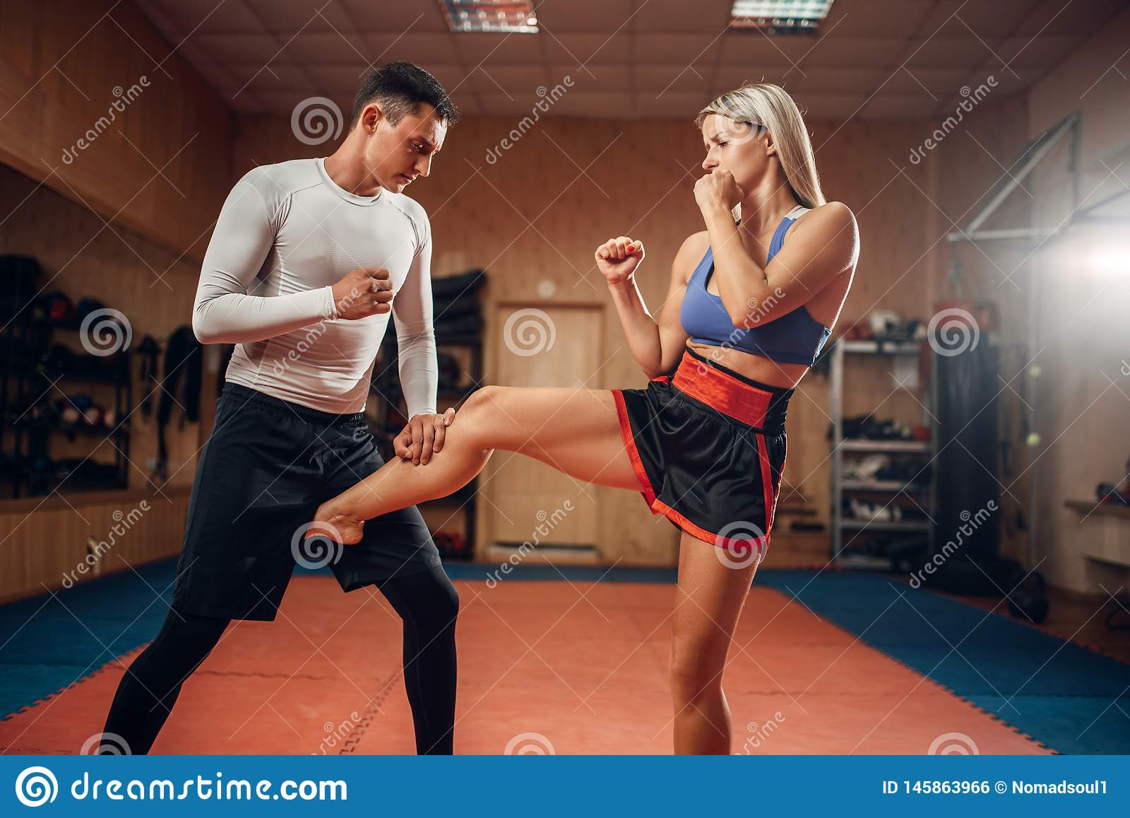 Female Person Makes Kick In Groin, Self Defense Stock
