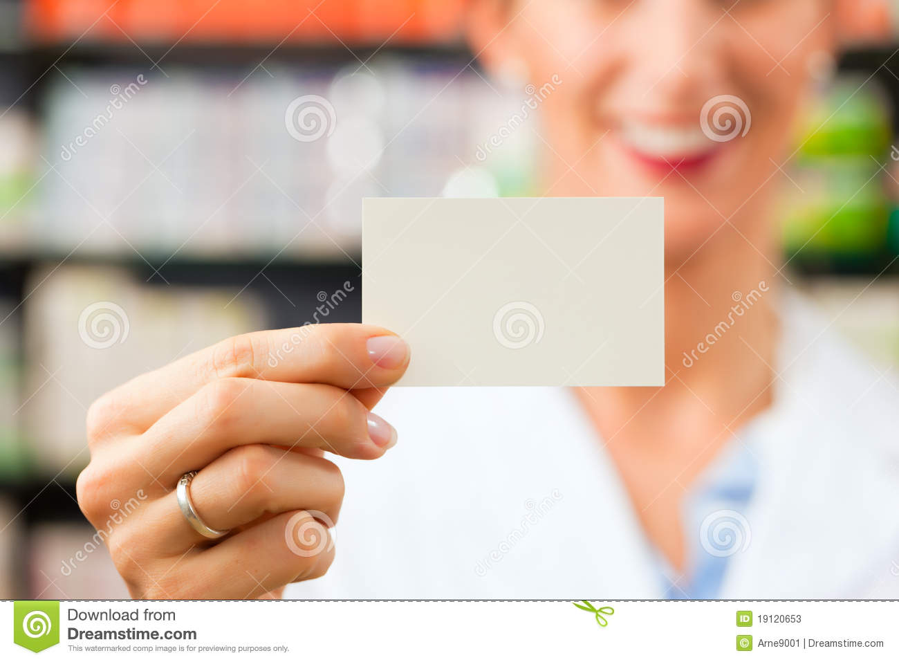 Female Pharmacist With Business Card In Pharmacy Stock Image ...