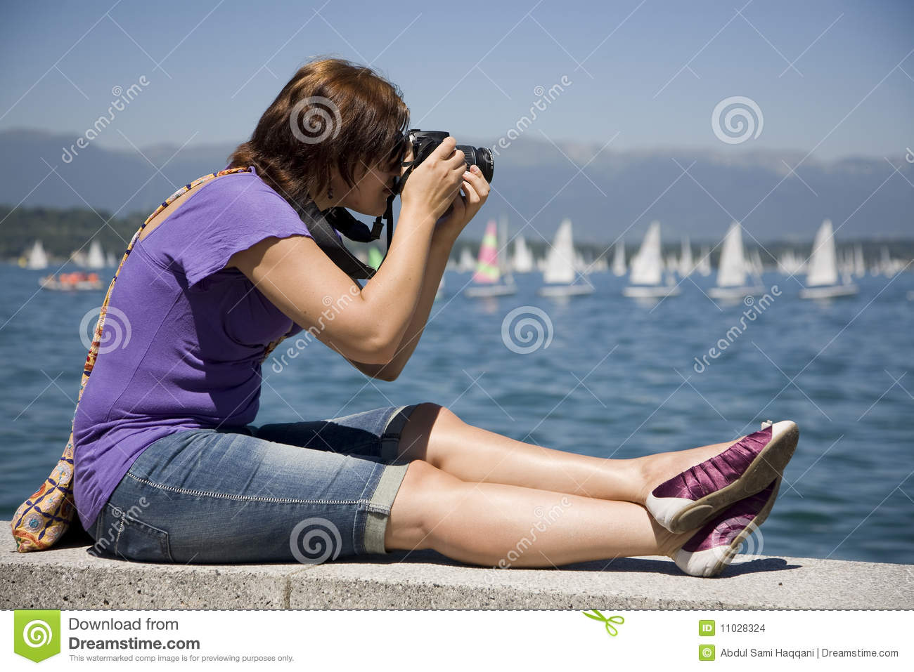 Female photographer by the water