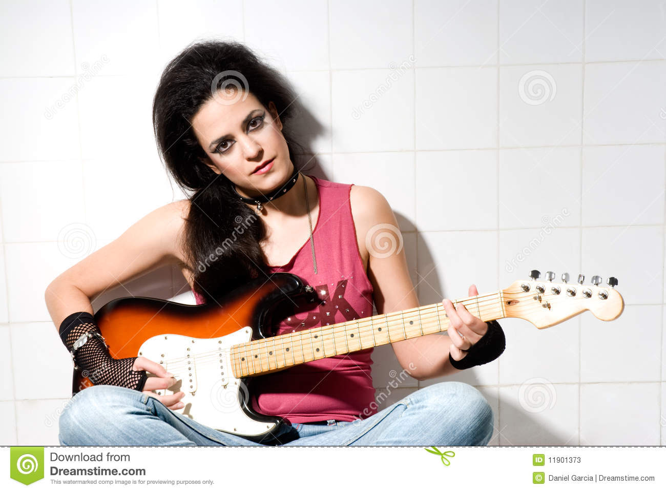 Female playing electric guitar