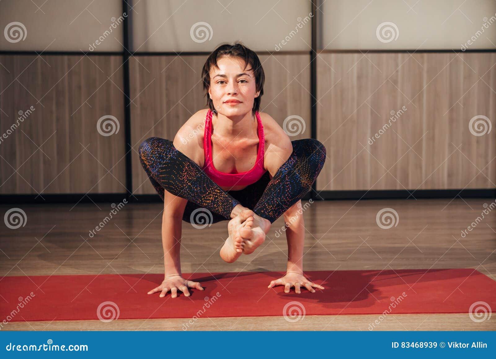 Female practicing yoga in a studio setting