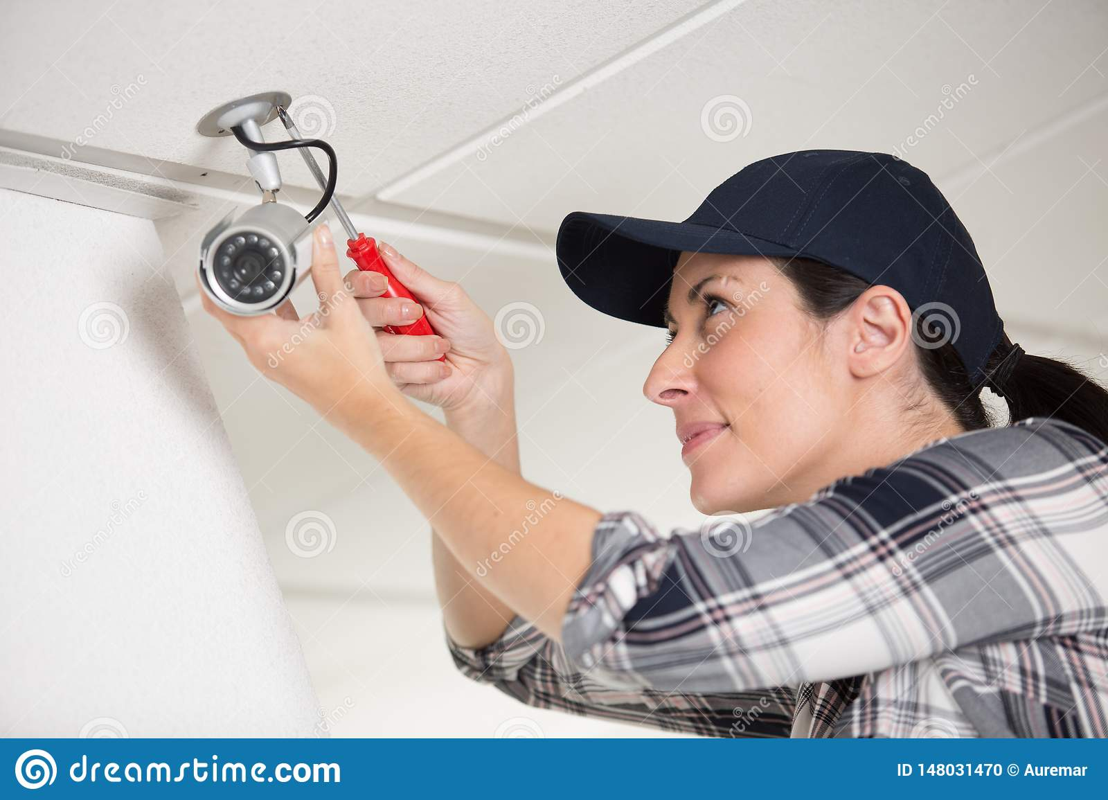 Female professional cctv technician working