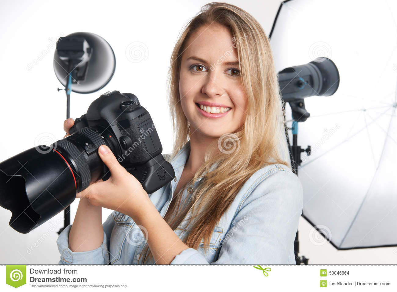 Female Professional Photographer Working In Studio Stock ...