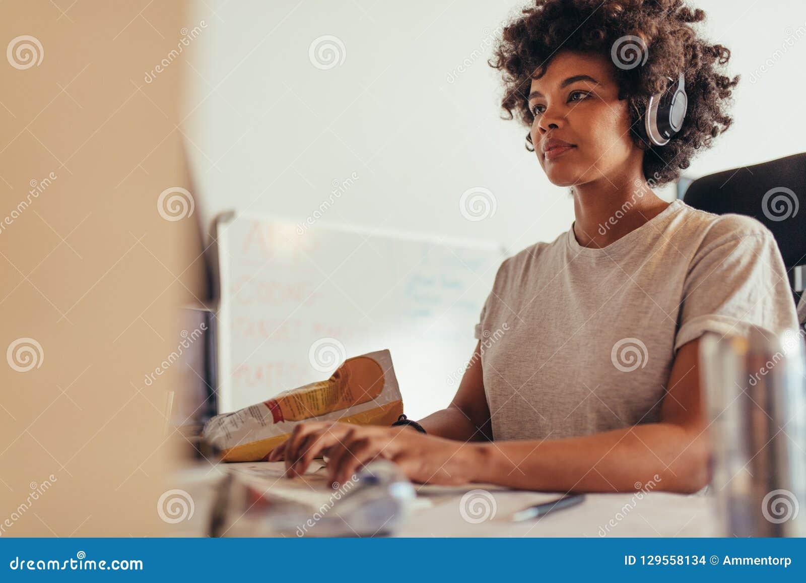 Female programmer typing data codes