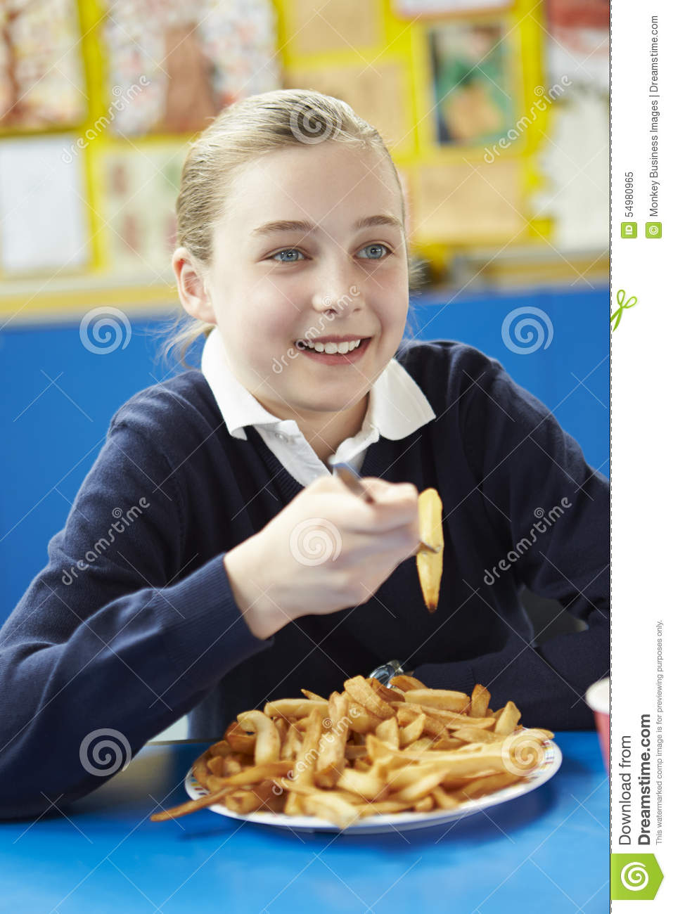 Female Pupil Eating Unhealthy School Lunch