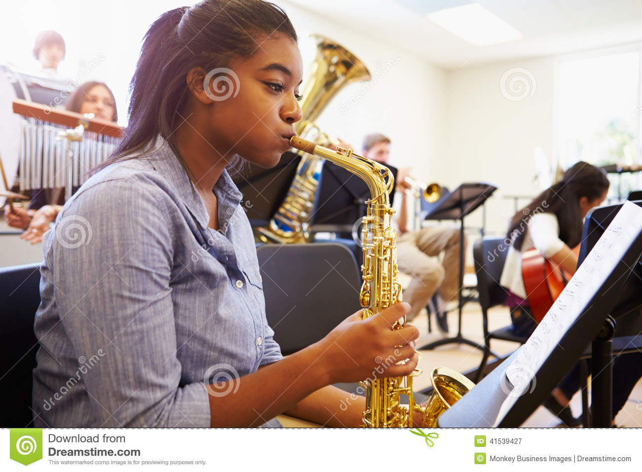 Download Female Pupil Playing Saxophone In High School Orchestra Stock Image - Image of african, drum: 41539427