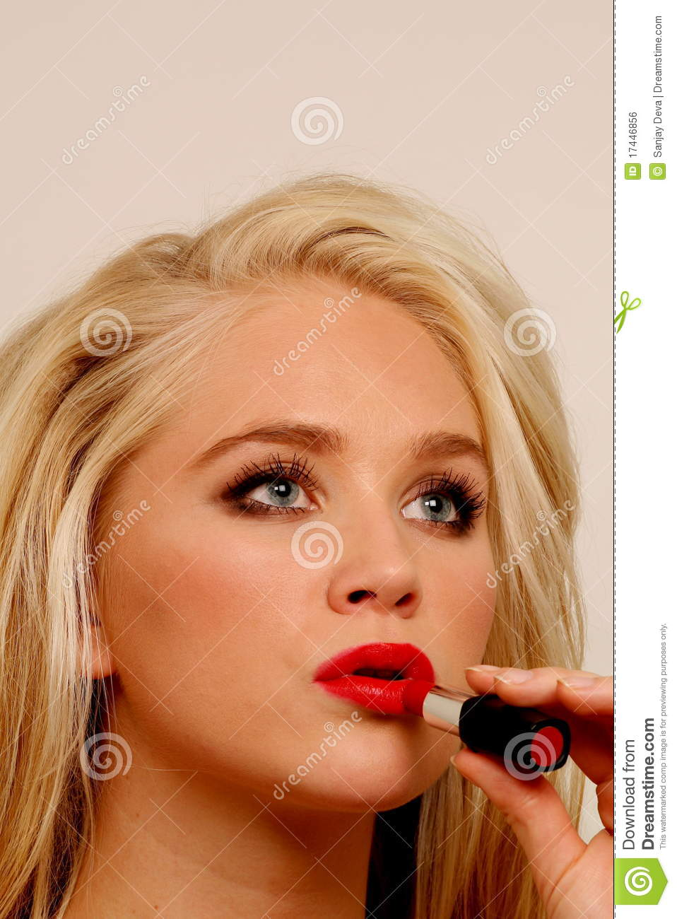 Female Putting On Lipstick Stock Photo. Image Of Stock