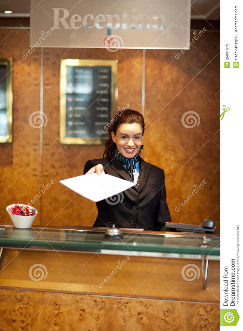 Female Receptionist Handing Over Check-out Papers Royalty ...