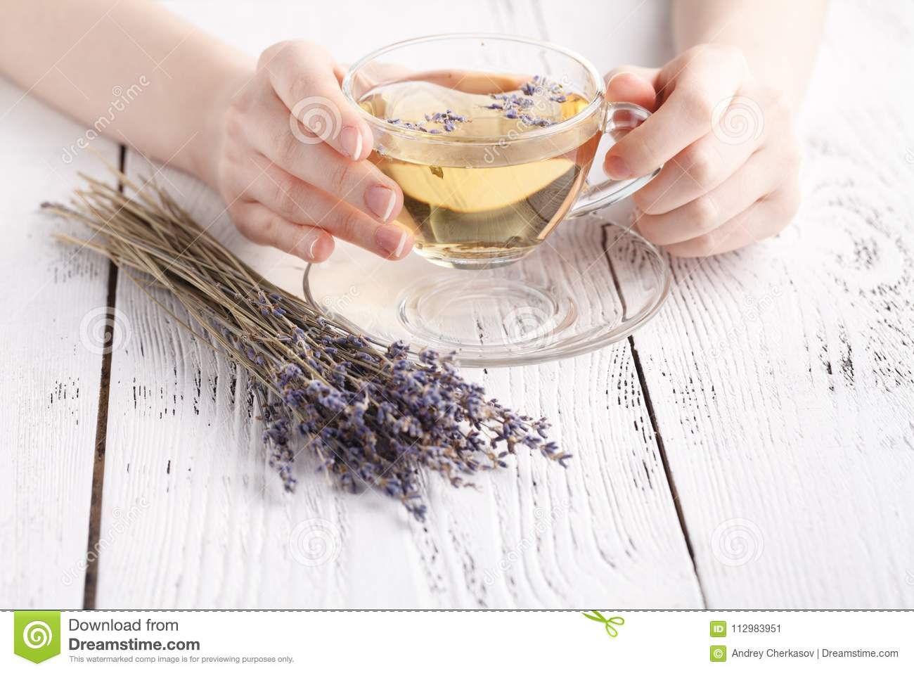 Female relax with cup of herbal tea