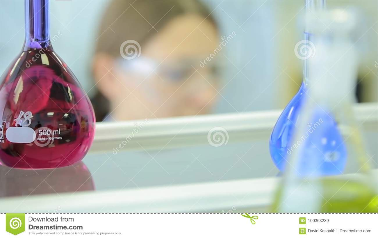 Female researchers carrying out research together in a chemistry lab research center color toned image shallow DOF