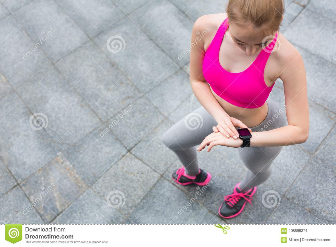 Young Female Jogger With Smartwatch Stock Photo - Image of