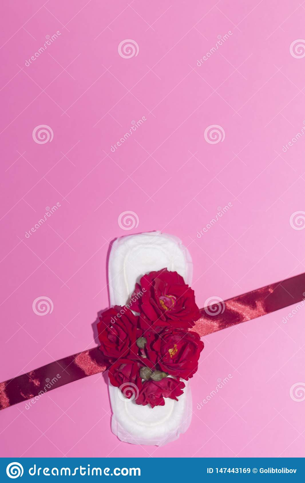 Female`s hygiene products on pink background. Concept of critical days, menstrual cycle, period days, PMS