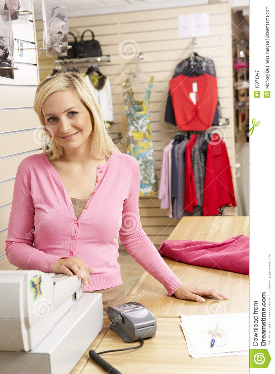 female s assistant in clothing store royalty stock share female s assistant in clothing store royalty stock