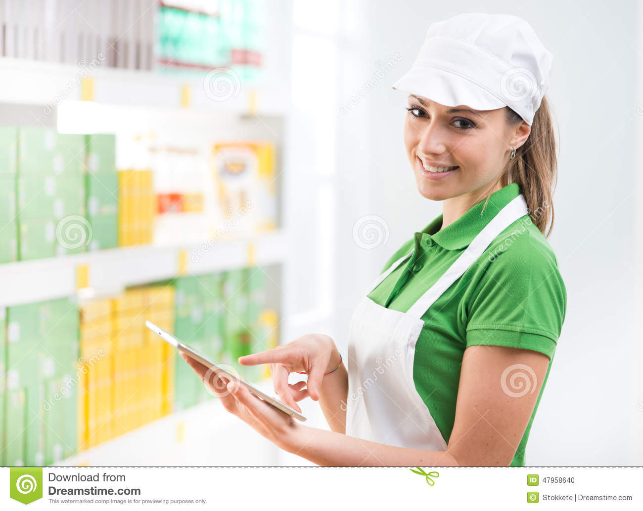 female s clerk tablet at supermarket stock photo image female s clerk tablet at supermarket stock photo image