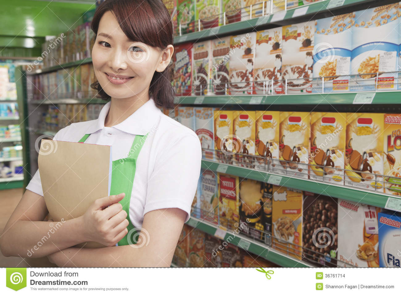 apron w s assistance clerk stock images image  female s clerk working in a supermarket stock images