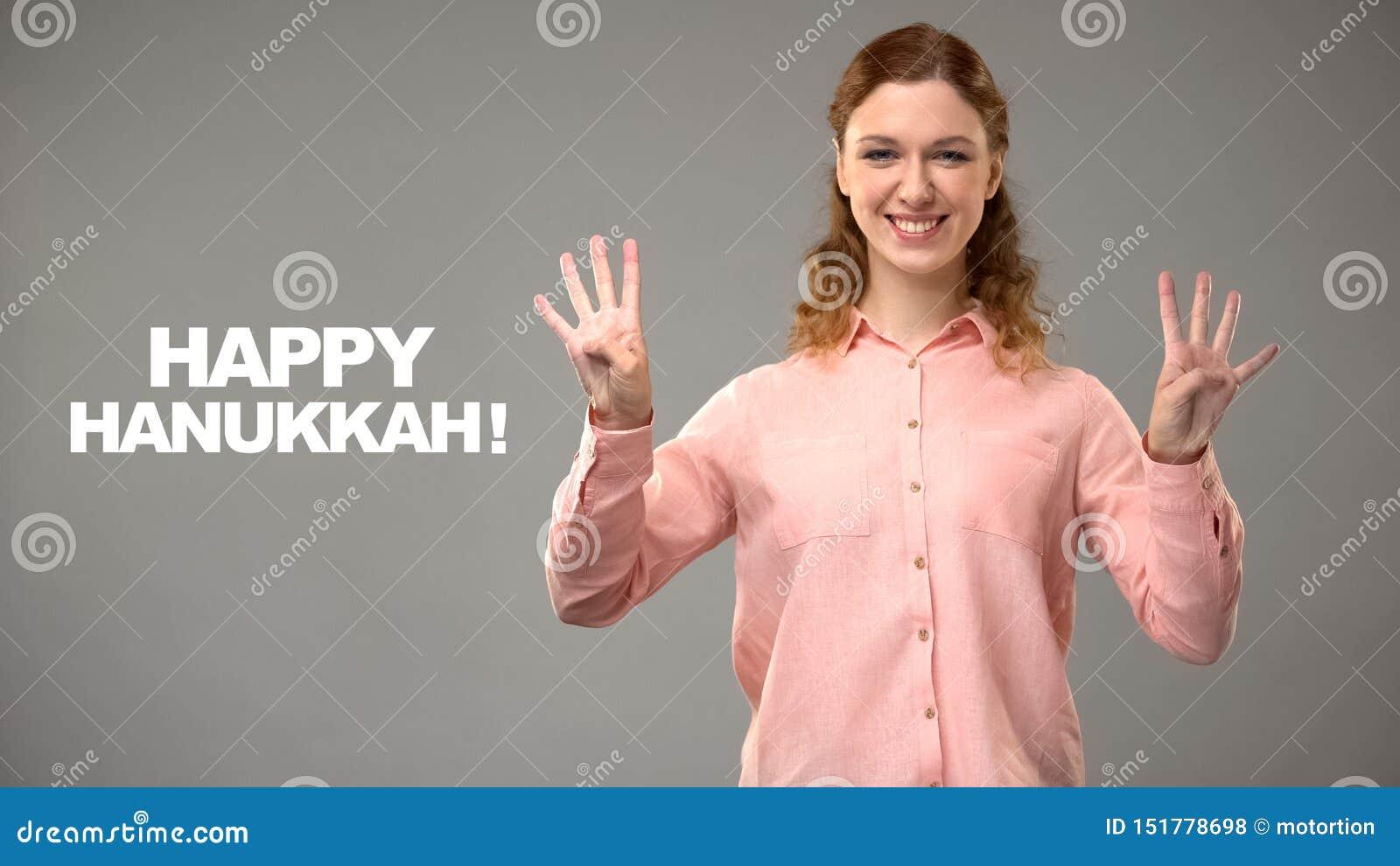 Female saying happy hanukkah in sign language, text on background, communication