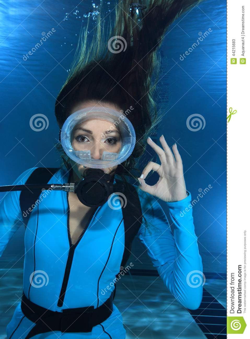 Female scuba diver with lycra suit show hand signal underwater in the ...