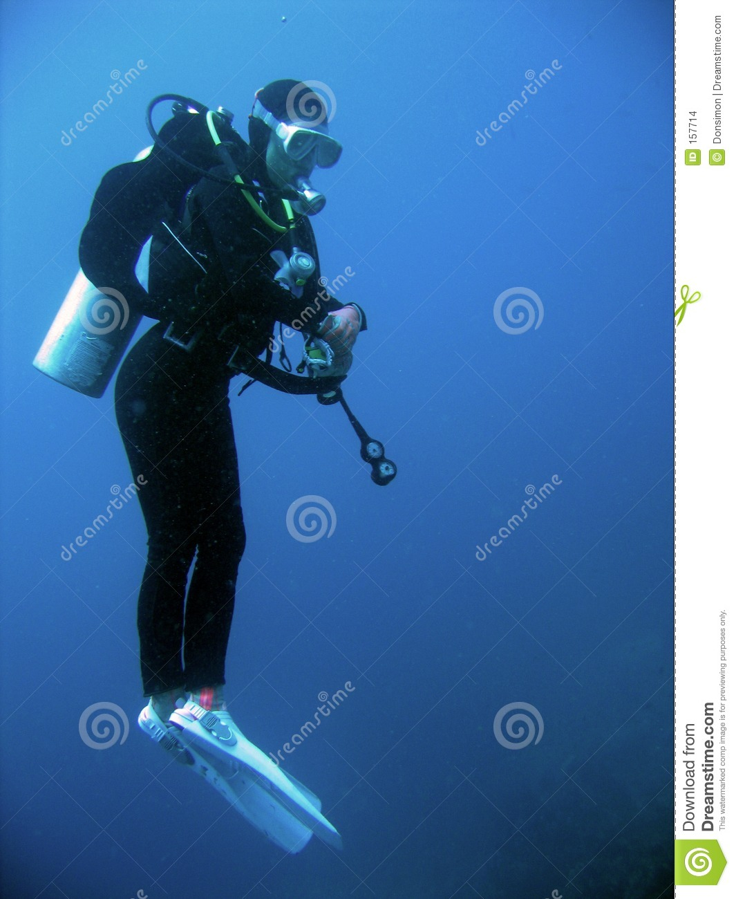 female scuba diver underwater philippines