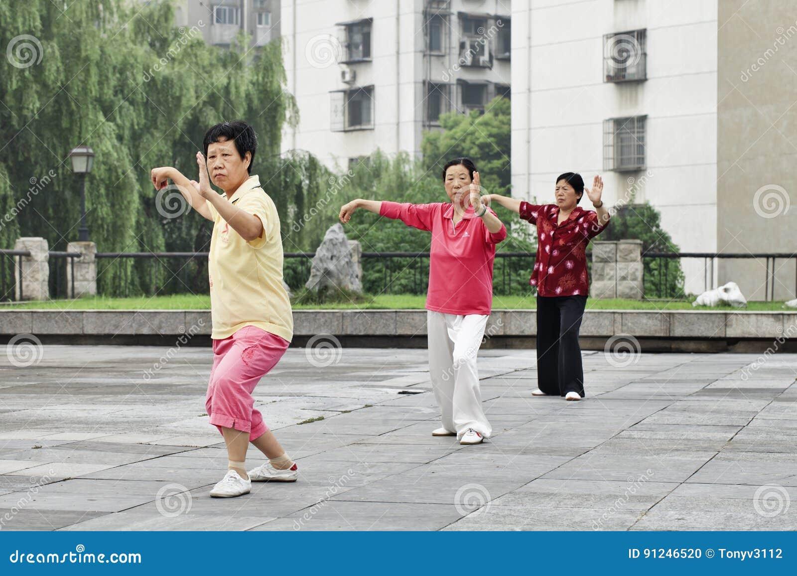 Female seniors practicing Tai Chi in the early morning, Xiang Yang, China