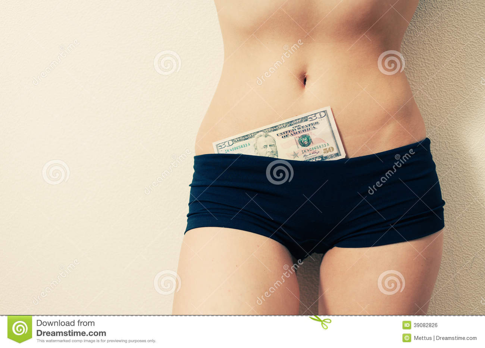 Female in shanties (tight shorts) with 50 dollar bill