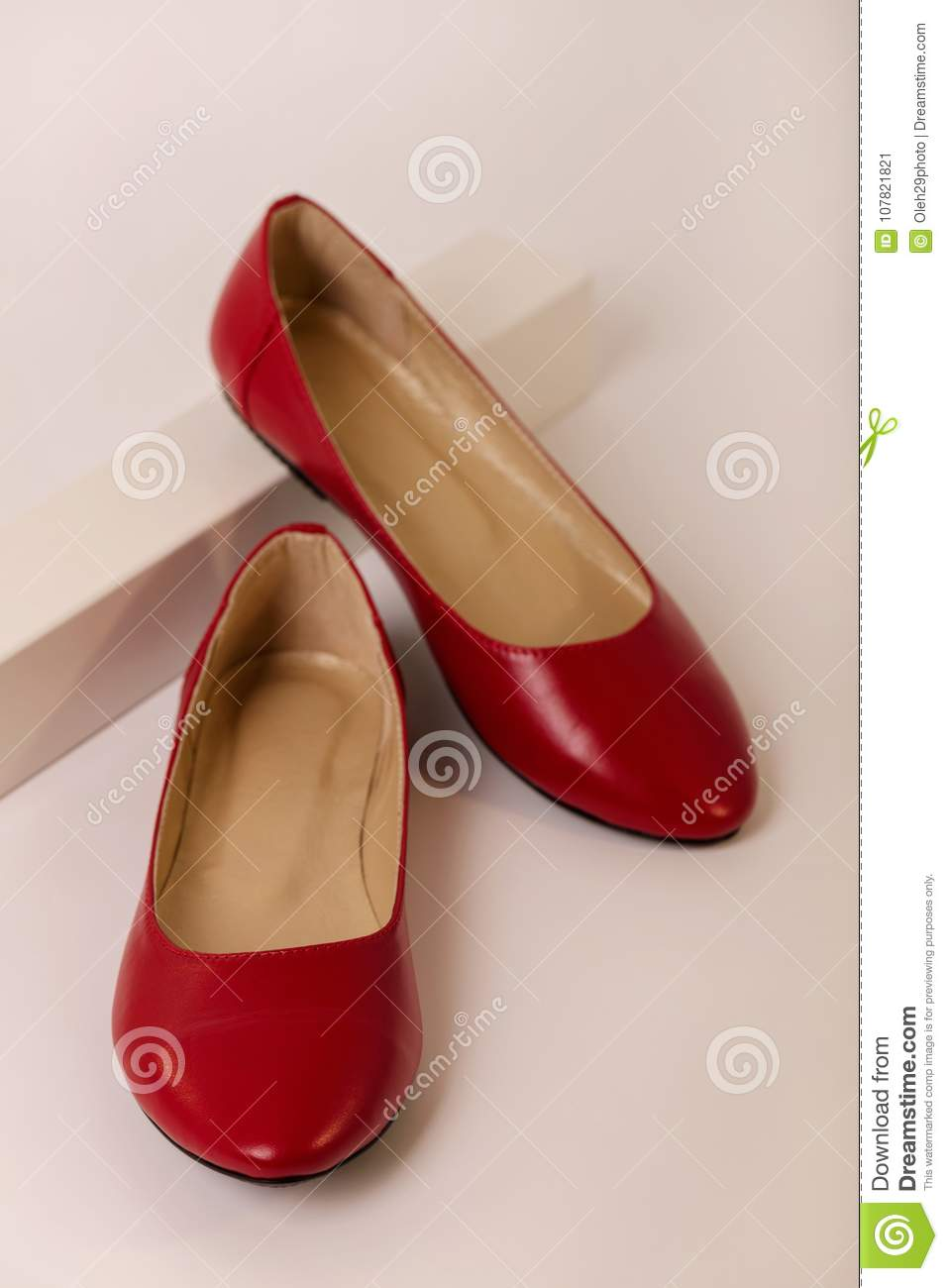 Female Shoes Of Red Color On A White