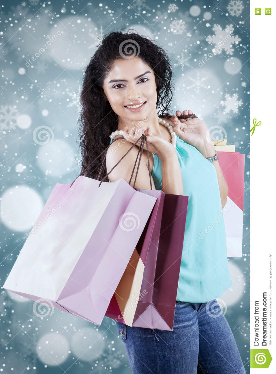Female shopper with winter background