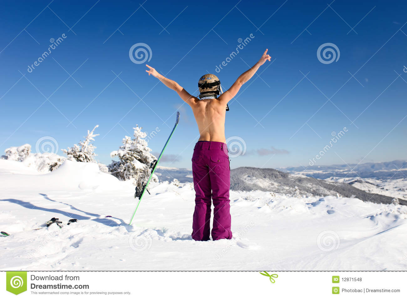 Female skier topless standing on the heel a back