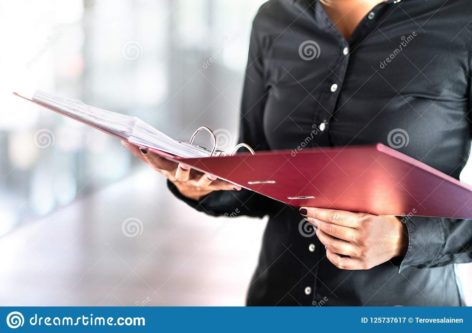 Female social worker, detective or business woman reading files.