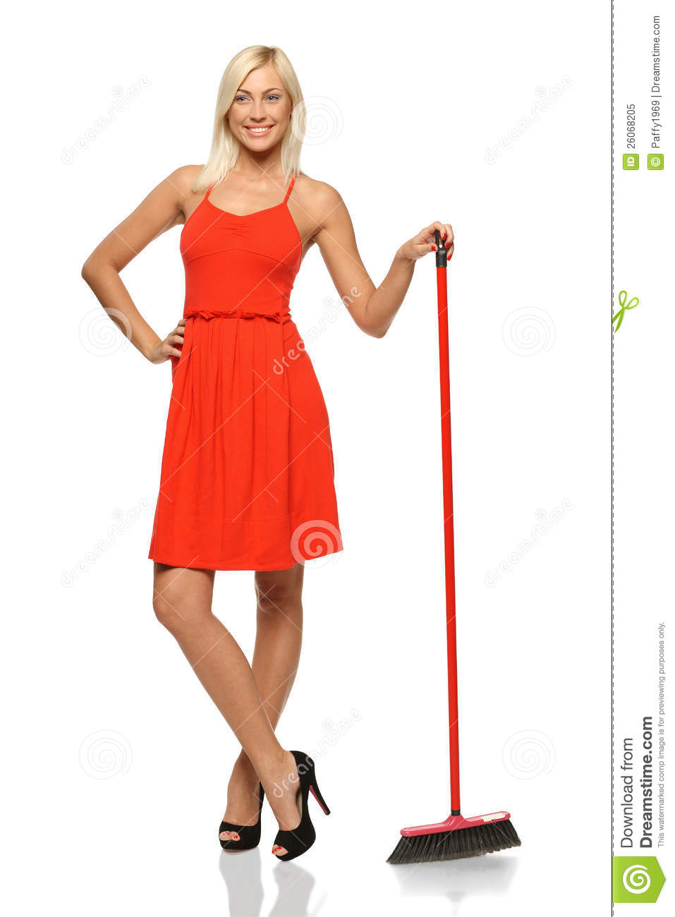 Girl Standing Sideways Looking Up Female standing with broom