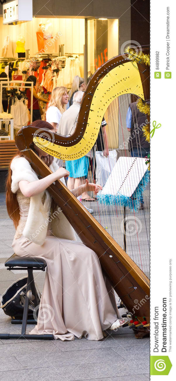 Female Street Performer Playing Harp Editorial Photography