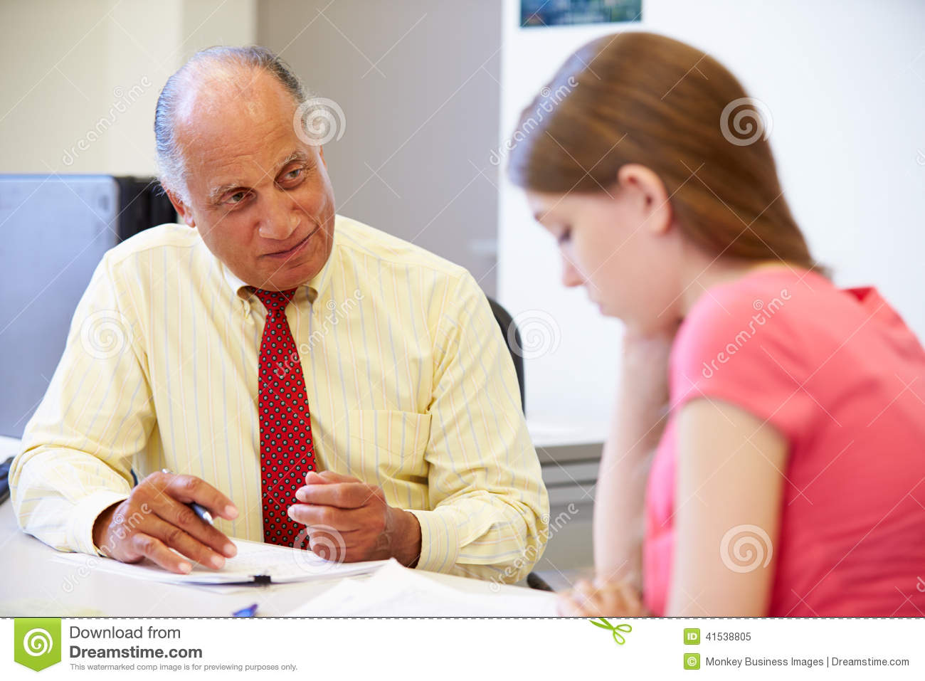 female student talking to high school councillor stock image - image