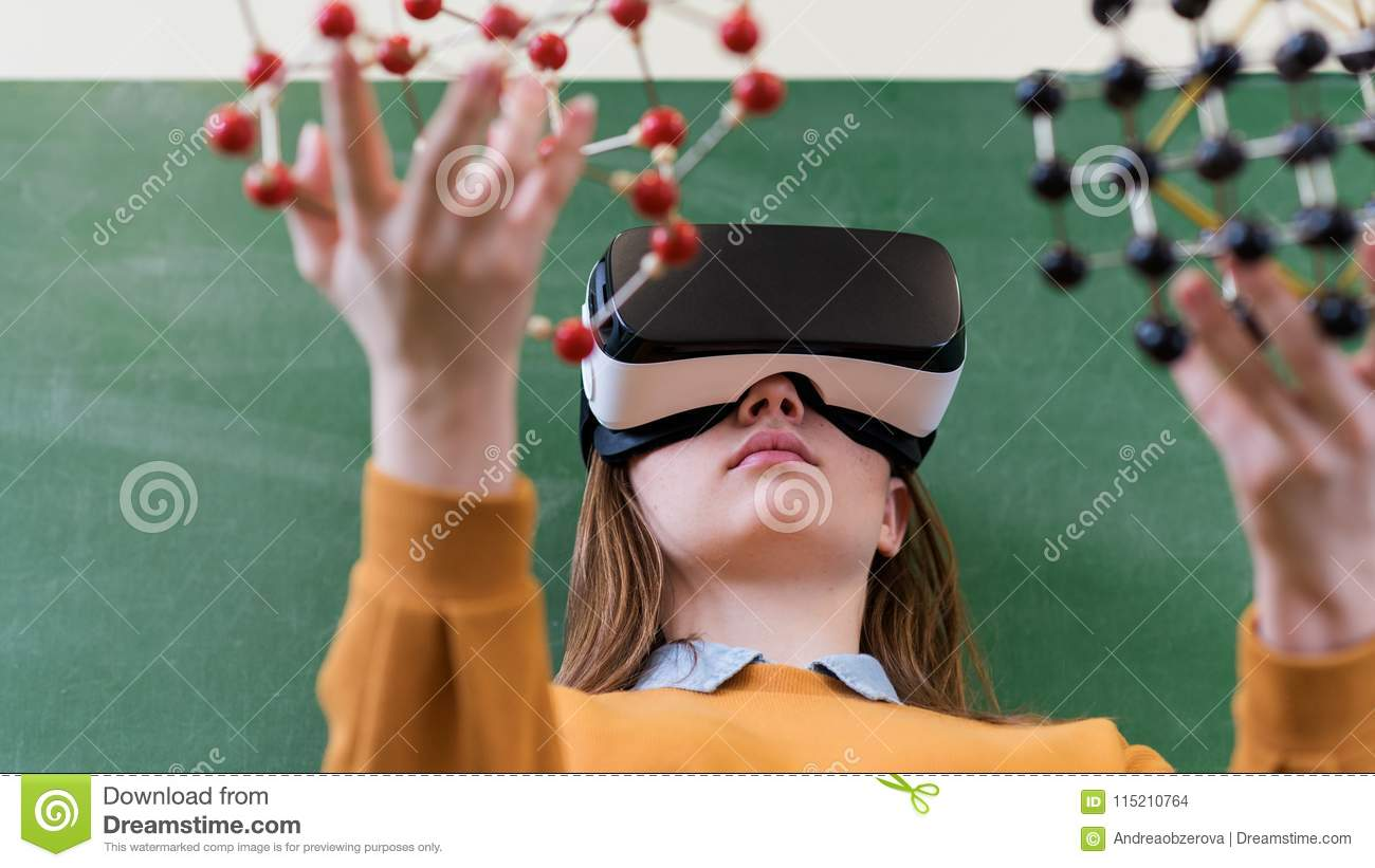 Female student wearing virtual reality glasses, holding molecular structure model. Science class, Education, VR, New Technologies.
