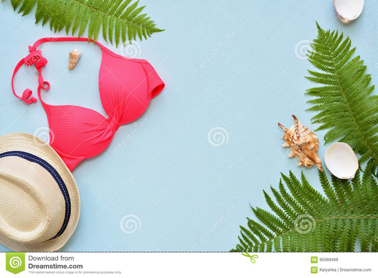 Female summer bikini swimsuit and accessories collage on blue with palm branches, hat and sunglasses.
