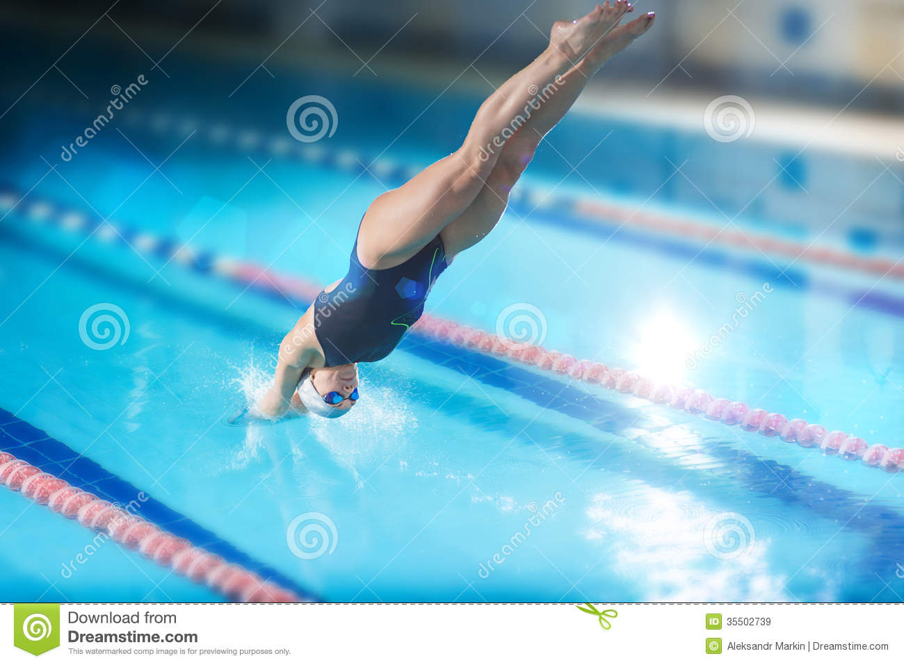 Female swimmer that jumping into indoor swimming pool for Swimming pool photos
