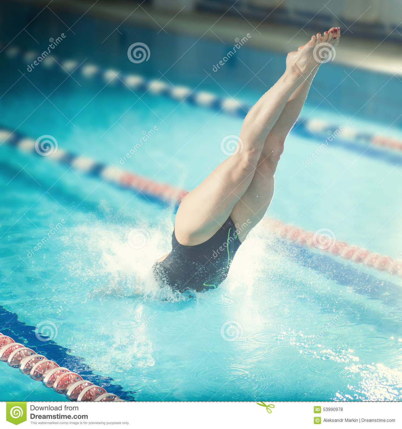 Female Swimmer That Jumping Into Indoor Swimming Stock